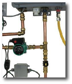 Tankless water heater with dedicated                                                              return line